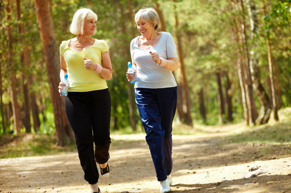 two-senior-women-running-in-the-forest