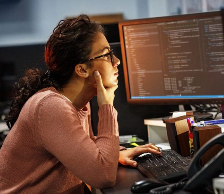 Female programmer working on new project.She working late at nig