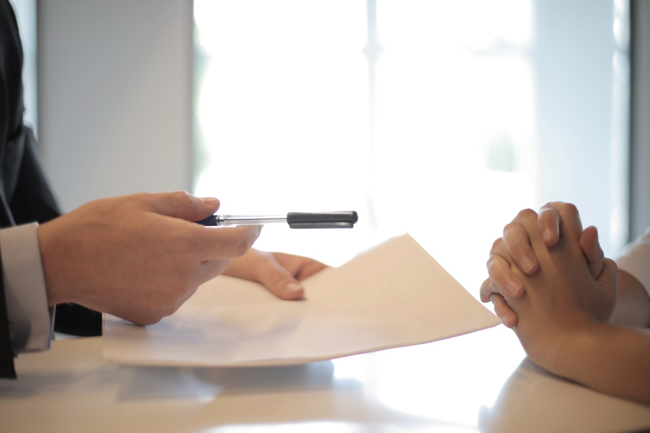 people signing a legal contract