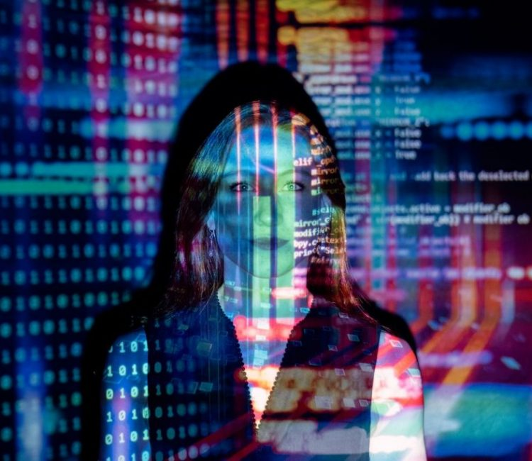 code projected over woman's face